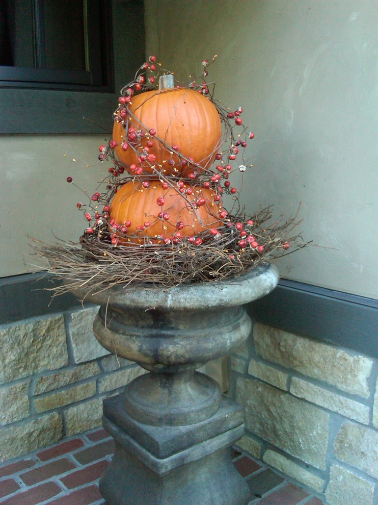 A tall planter could be filled with pumpkins, bittersweet and grapevine spiral wreaths.