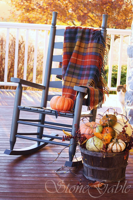 A plaid blanket is a necessary fall addition to any chair you have on your porch.