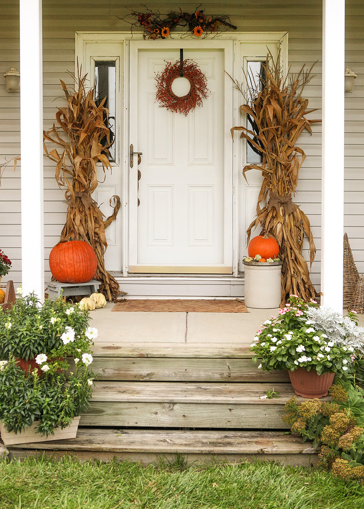 Pumpkins, fall flowers, dried corn stalks and flea market finds could make any porch looks according to the season.