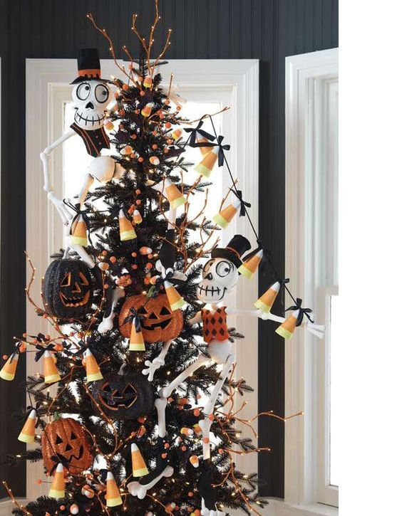 a black Halloween tree with candy corn garlands, bones, glitter jack-o-lanterns and lights is a bold idea