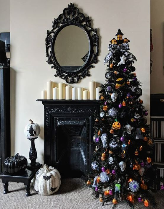 a black Halloween tree with skulls, spiders, webs, pumpkins, colorful ornaments is a stylish and moody decoration