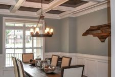 a catchy and contrasting ceiling in white and stained wood plus matching furniture make the space very stylish