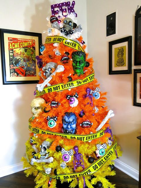a color block Halloween tree in orange and yellow, with skeletons, eyeballs, bones and masks is crazy