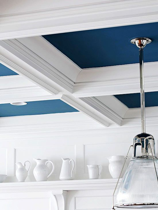 a contrasting navy and white ceiling with molding is a gorgeous idea to add color to the space and make it dimensional