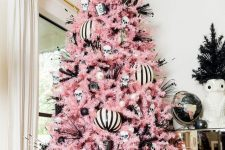 a creepy cute Halloween tree with black and white ornaments, striped ones, jack-o-lanterns and twigs