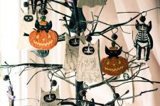 a mini black Halloween tree with skeleton cats, bats and pumpkins is a very cool and fun idea