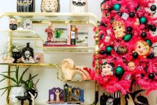 a pink Halloween tree with colorful ornaments and scary masks for a bold interior