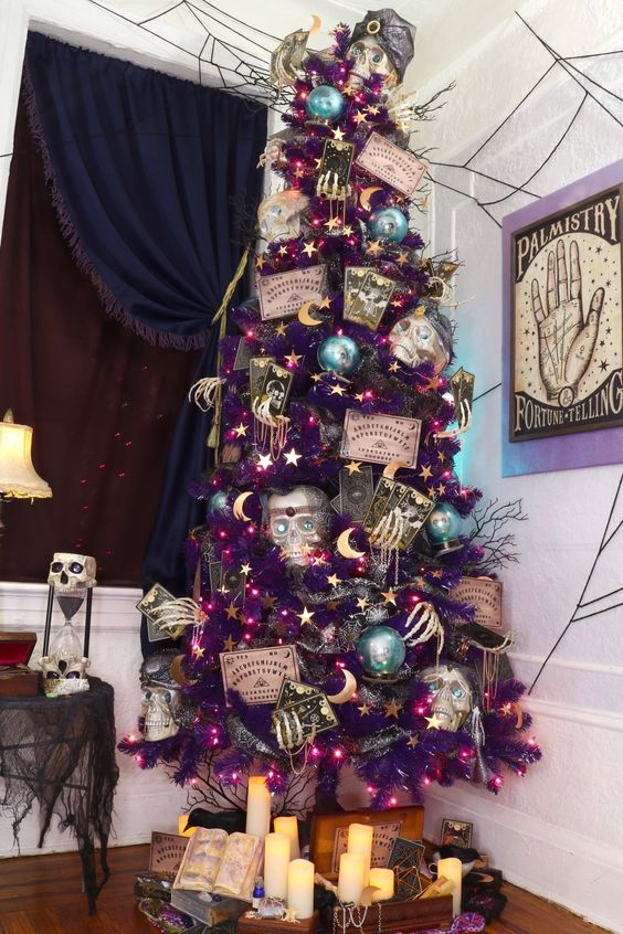 a purple Halloween tree with skeleton hands, skulls, cards and stars is a gorgeous and unique decoration