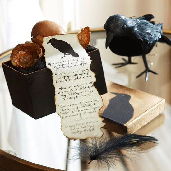 a stylish Halloween party invite with a raw hem and a blackbird in a black box with eggs