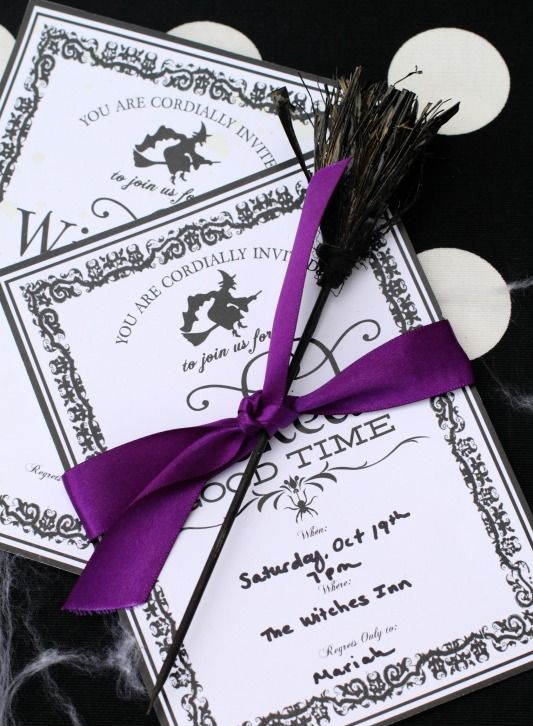 black and white Halloween party invitations with purple ribbons and brooms is a nice idea for a witch-themed party
