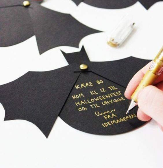 black bat invitations with gold letters are simple and very cool, they look glam and bold