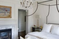 chic and elegant molding on the ceiling plus a crystal chandelier create a gorgeous backdrop for super elegant furniture