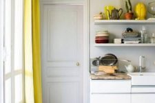 chic ceiling trim and molding painted yellow and matching yellow curtains add a sunshine feel to the space