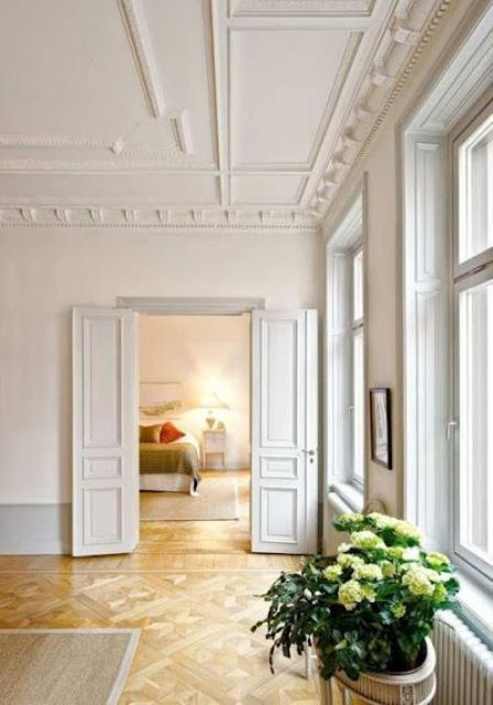 chic vintage ceiling molding plus trim and molding on the doors is a gorgeous way to add style to the space