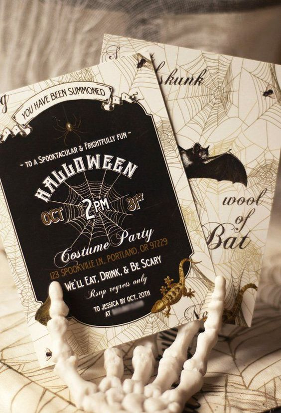 elegant black, white and gold Halloween party invitations with bat, spider and lizard prints are chic