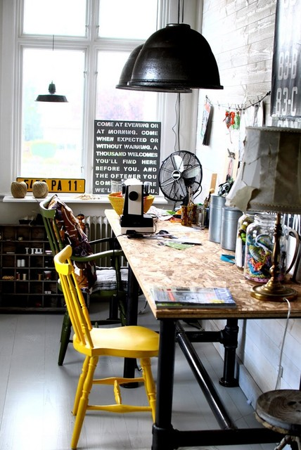 goergeous industrial home office design with mixed chairs