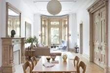 gorgeous vintage molding on the ceiling matches the window decor and fireplace with a chic feel