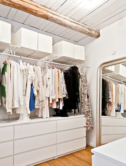 ikea malm and hanging shelves for a simple and stylish walk-in closet