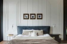 laconic modern molding on the ceiling is continued on the wall to make a statement in the bedroom