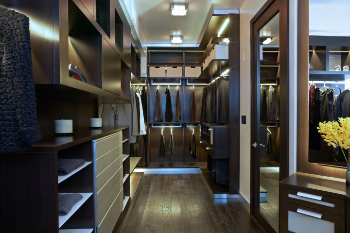 masculine walk-in closet deisgn in only dark tones
