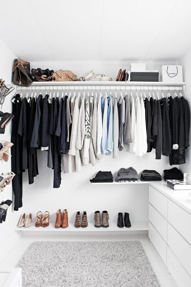 modern all-white walk-in closet with a basic gray ikea Alhede rug