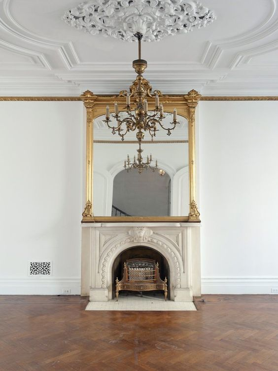 molding and a gorgeous ornate medallion plus a fantastic chandelier and a fireplace create a roayl-worthy space
