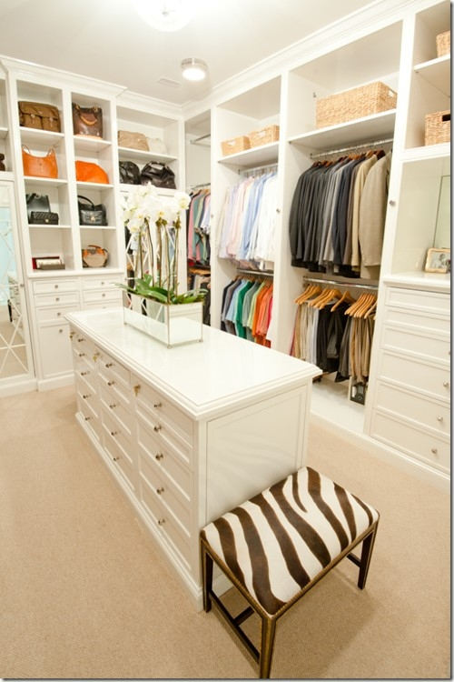 spacious walk-in closet with a dresser in a middle
