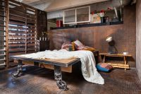 steel diamond plates make this room super unusual but a bed is still the centerpiece