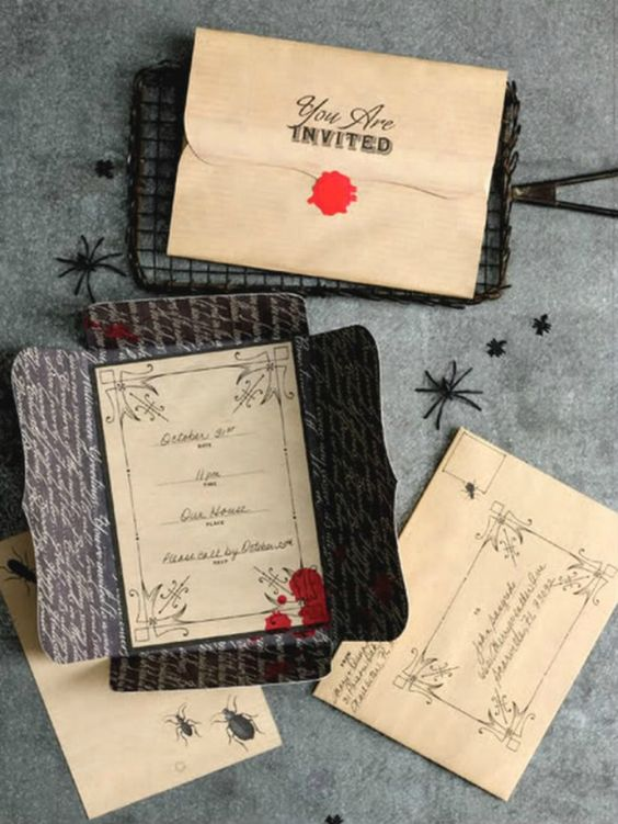 vintage invitations with blood stains and in chic and refined black envelopes are very cool