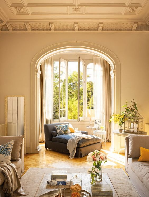vintage molding and trim plus an arched doorway make the space vintage, yet the neutral soft shade add a relaxing feel