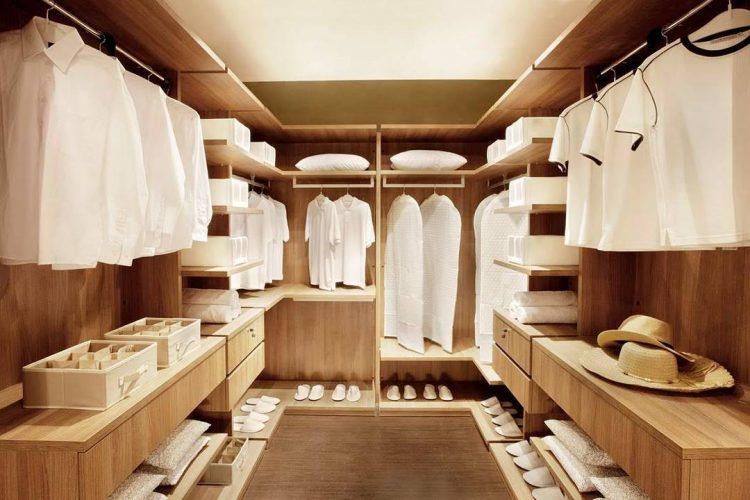 walk-in closet wardrobe in light wood tones