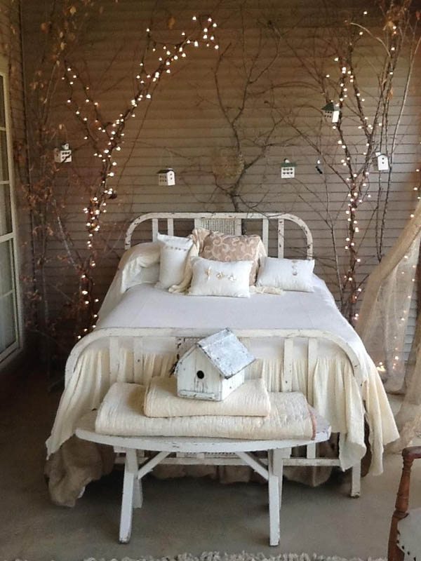 If you want to wake up in a room full of holiday cheer then Christmas lights hanging from dried twigs is a perfect solution for you.