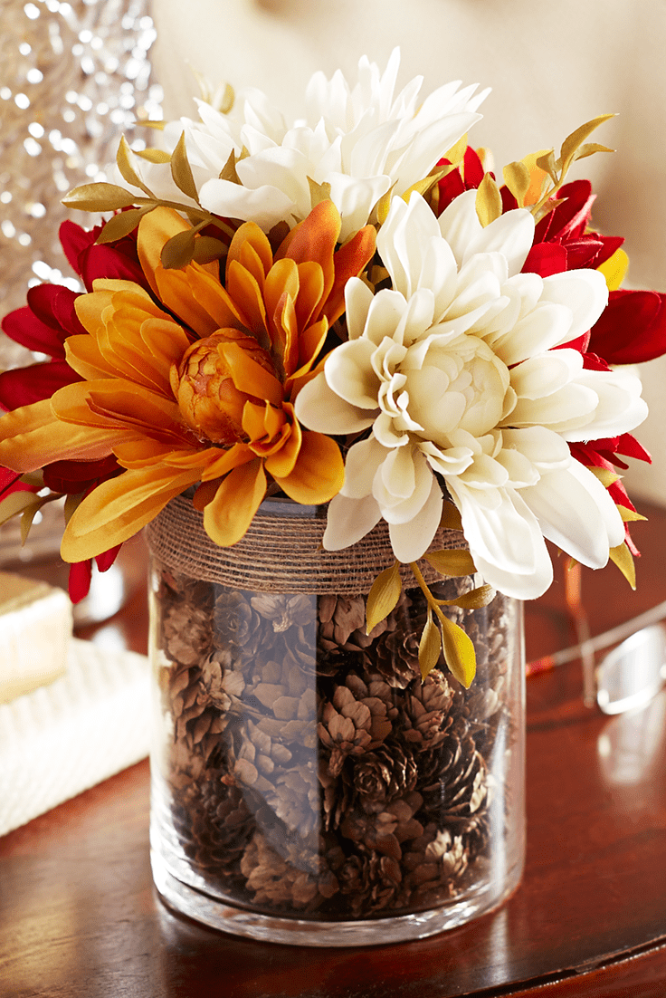 Faux Dahlias In A Vase Filled With Pinecones Makes Perfect Tabletop Focal  Point.