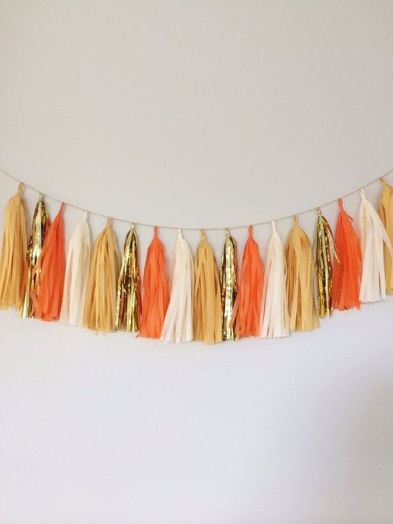 a bright orange, rust, gold and white tassel garland for fall and Thanksgiving is a cool decoration