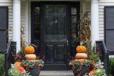 a cozy and easy fall porch with natural pumpkins, greenery and foliage, stacked pumpkins in pots is easy to recreate