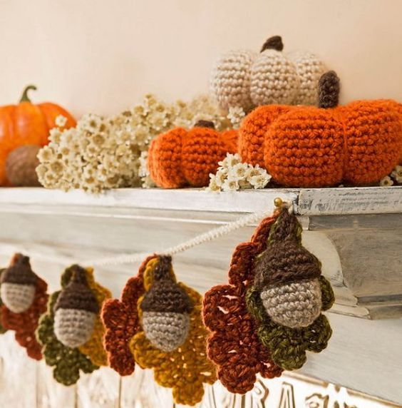 a crochet acorn and leaf garland will cozy up your space for the fall or Thanksgiving