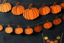 a drawn pumpkin garland of paper is a sytlish and easy idea for Thanksgiving, use bold colors