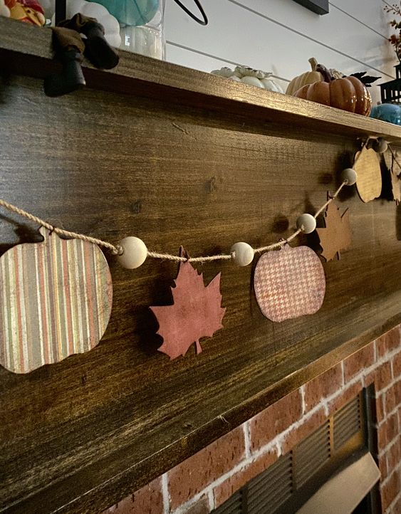 a fall garland of plywood pumpkins, leaves and wooden beads is a lovely idea for Thanksgiving