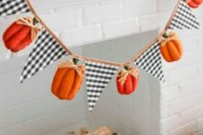 a fall or Thanksgiving garland of plaid triangles and pumpkins with twine is a stylish decoration with a rustic feel