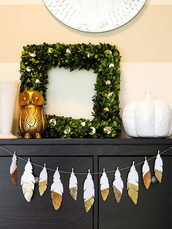 a feather garland of color block metallic pieces is a nice boho garland for the fall or Thanksgiving