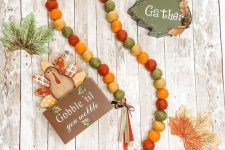 a felt bead garland done in fall colors, tassels and ribbon bows is a nice decor idea you can eaisly realize