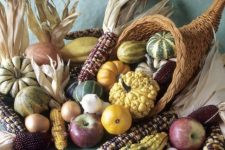 a large cornucopia with gourds, pumpkins, corn and apples is a lovely traditional Thanksgiving centerpiece to rock
