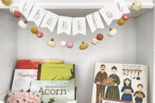 a letter garland and a felt pumpkin and ball one to decorate your space for Thanksgiving and fall