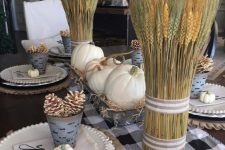 a metal tray with hay and white pumpkins and wheat bundles are ideal for a rustic Thanksgiving tablescape
