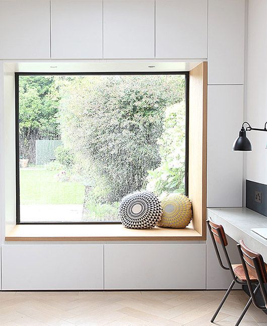 a minimalist windowsill reading nook with drawers for storage under it - you can store your books there