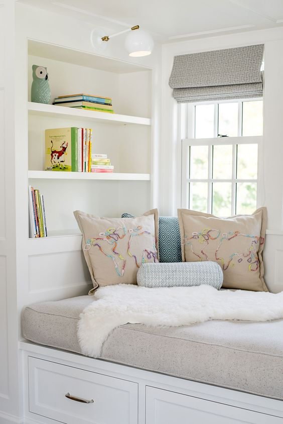 a modern windowsill seat with an upholstered space and built-in shelves plus drawers for storage