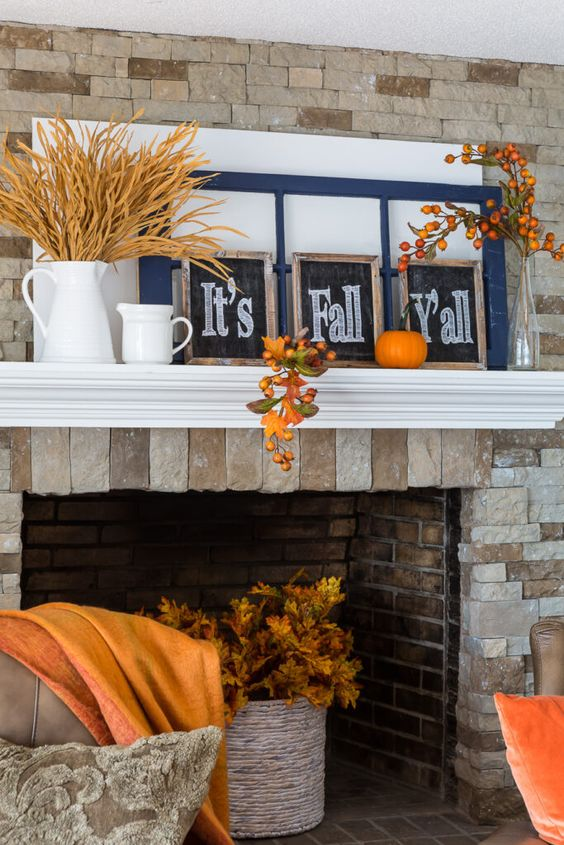 a rustic Thanksgiving mantel with a faux pumpkin, faux berries and leaves, wheat and bright signs