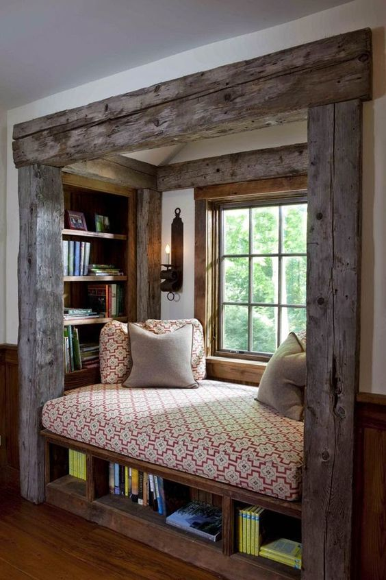 a rustic windowsill reading nook with a cool upholstered bench, built-in shelves under it and on each side