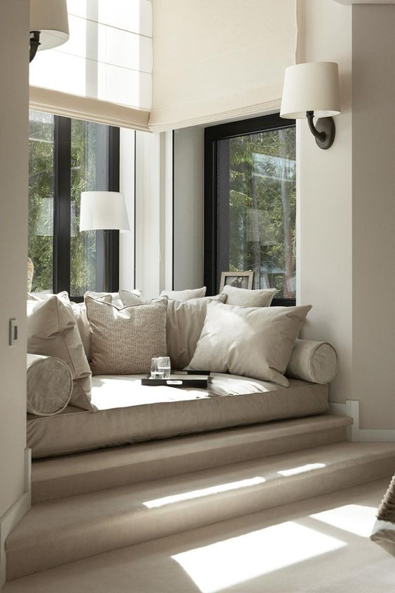 a stylish modern readin nook with a comfy daybed and pillows, wall sconces is an ideal reading or chilling nook