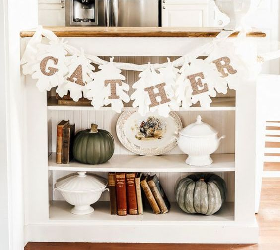 a white leaf garland with glitter letters is a stylish and easy modern decoration for Thanksgiving